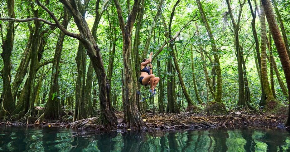 Woman ziplining in Tahiti