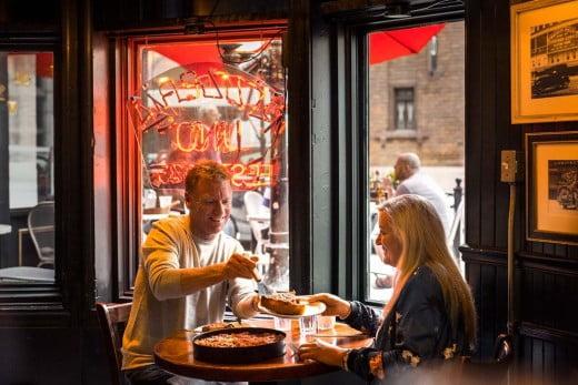 A couple enjoying a deep dish pizza, Chicago.