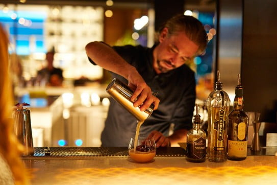 Cocktail making bartender, Hawaii, United States.