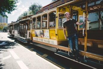 Man on cable car, San Francisco, USA.
