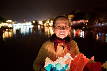 Floating candle seller, Hoi An, Vietnam.