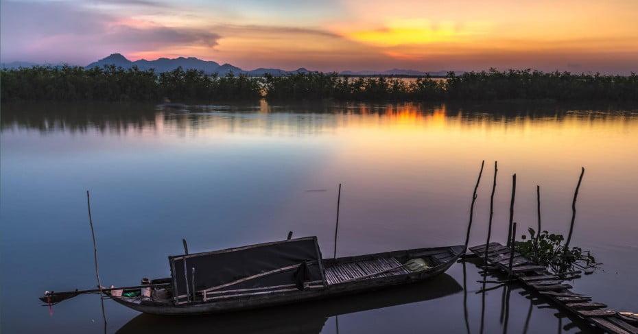 Rowboat at sunset, Vietnam.