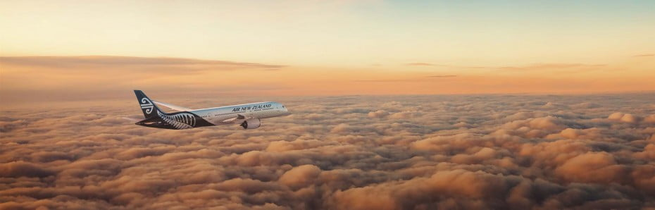 Air New Zealand 787-9 flying above the clouds at dusk.