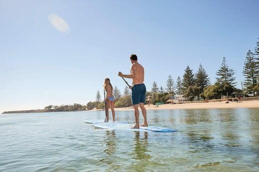 Paddle boarding at Palm Beach, Gold Coast, Australia.