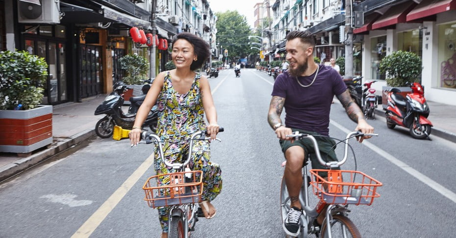 Tourists cycling through Former French Concession, Shanghai, China.