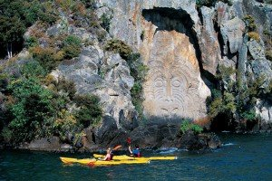 Kayak along Maori Rock Carving at Mine Bay, Lake Taupo, New Zealand